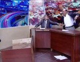 Jordanian MP Mohammad Shawabka threw one of his shoes at political opponent Mansour Sayf al-Din Murad during a television debate before pulling a gun on him