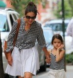 Katie Holmes and Suri are believed to have been riding in the back of a black Mercedes sedan when it was struck by a sanitation truck