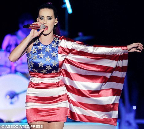 Katy Perry giving a star-spangled performance in the Brooklyn Navy Yard, donning her uniform of a purple ponytail and an American flag mini-dress