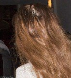 Lindsay Lohan flashed a big bald patch at the back of her head by her crown