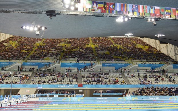 Olympic organizers are investigating why many seats were empty during events at venues including the Aquatics Centre in east London