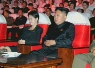One picture taken during the performances showed the mystery woman with her hand on the armrest of Kim Jong-Un's chair
