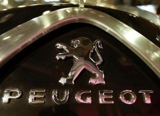 Peugeot has reported a loss of 819 million Euros ($1 billion) for the first half of the year