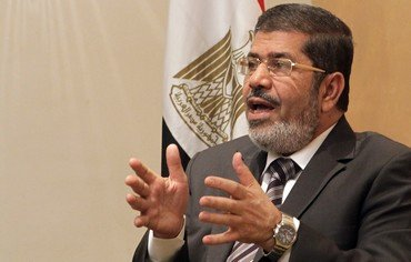 President Mohammed Mursi has ordered Egyptian parliament to reconvene, a month after it was dissolved