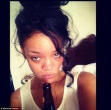 Rihanna tweeted a picture of herself, make-up free and holding what appears to be a beer in her hand