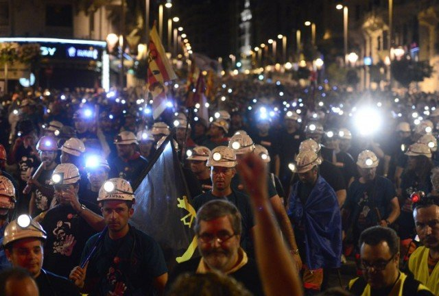 Spanish coal miners came to march in Madrid with helmets on their heads and the worried look of men with no future on their faces