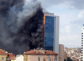 Television footage showed the Polat Tower building engulfed in thick black plumes of smoke, with pieces of debris falling to the ground
