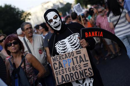 Tens of thousands of people held largely peaceful protests across Spain against the latest government austerity measures