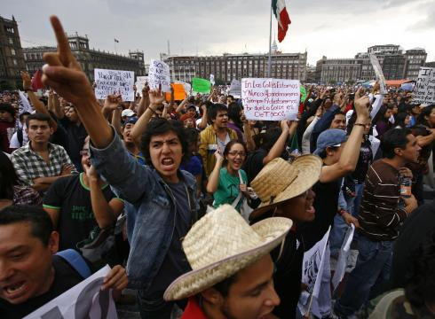 Tens of thousands of people in Mexico City are marching against the result of the presidential election, which was won by Enrique Pena Nieto