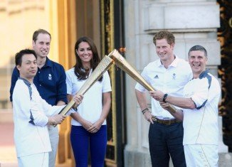The Olympic torch has been welcomed to Buckingham Palace by members of the royal family, including Princes William and Harry and the Duchess of Cambridge