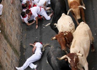 This year's Pamplona bull running festival kicked off today with one thrill-seeker was gored in a leg and four others injured