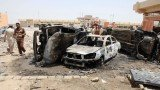 Waves of bomb attacks and shootings in north of Baghdad have killed at least 82 people