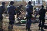 At least 30 people have been killed after South African police clashed with striking miners at Lonmin Marikana mine on Thursday