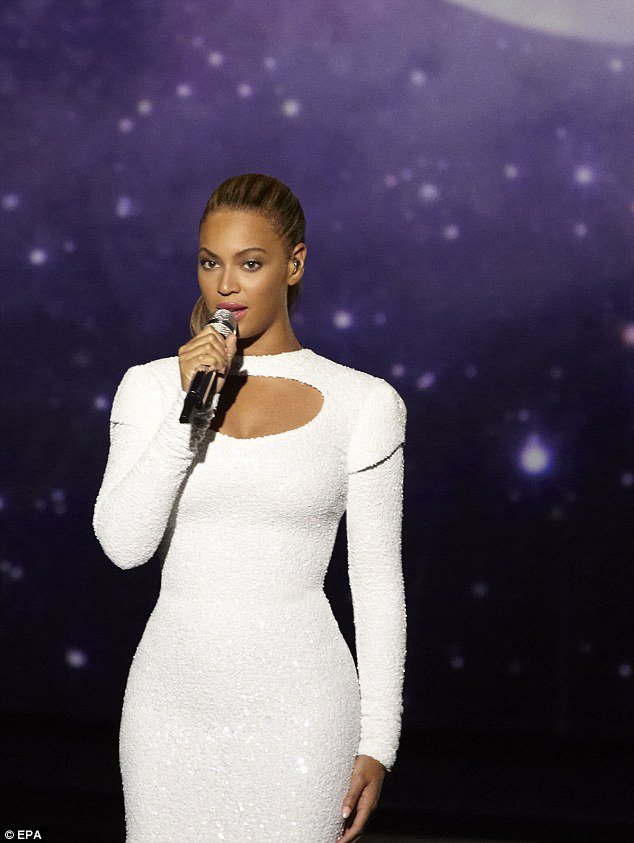 Beyoncé's new video shows the 30-year-old singer slipping into a gorgeous white sequinned gown to perform her 2011 track I Was Here for World Humanitarian Day