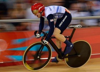 British cyclist Jason Kenny powered to victory over Frenchman Gregory Bauge in the men's sprint in front of 6,000 baying fans
