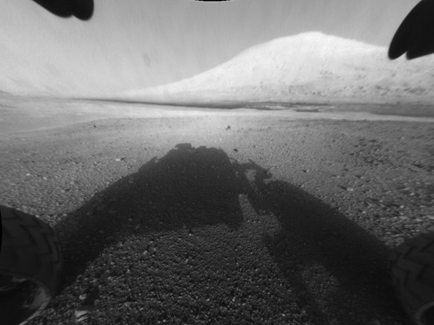 Curiosity rover on Mars has returned black and white images that capture part of its own body, its shadow on the ground and views off to the horizon