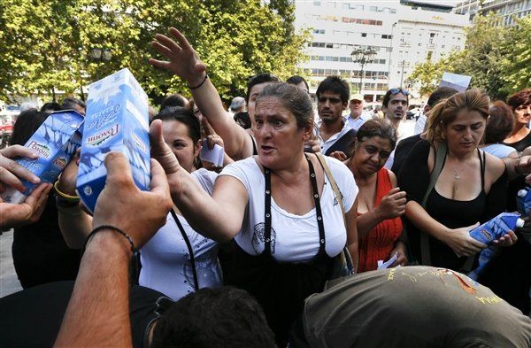 Far-right Golden Dawn party has handed out free food to hundreds of struggling people in central Athens, but only to Greek nationals
