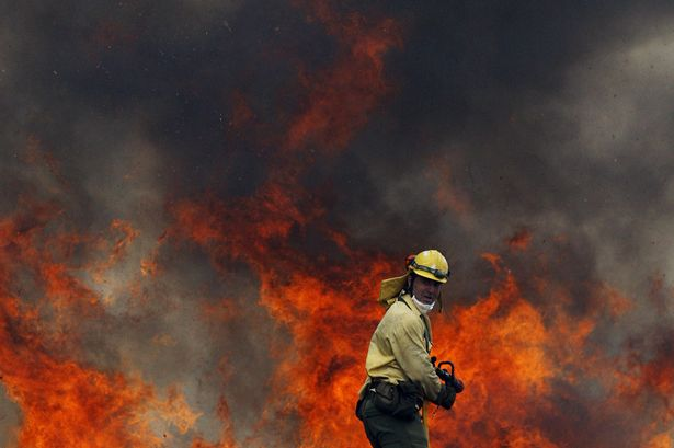 Firefighters are battling a huge wildfire raging near the wealthy resort of Marbella on Spain's Costa del Sol