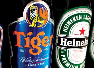 Heineken has agreed to buy Fraser and Neave's controlling stake in the maker of Tiger beer in a deal worth 5.6 billion Singapore dollars