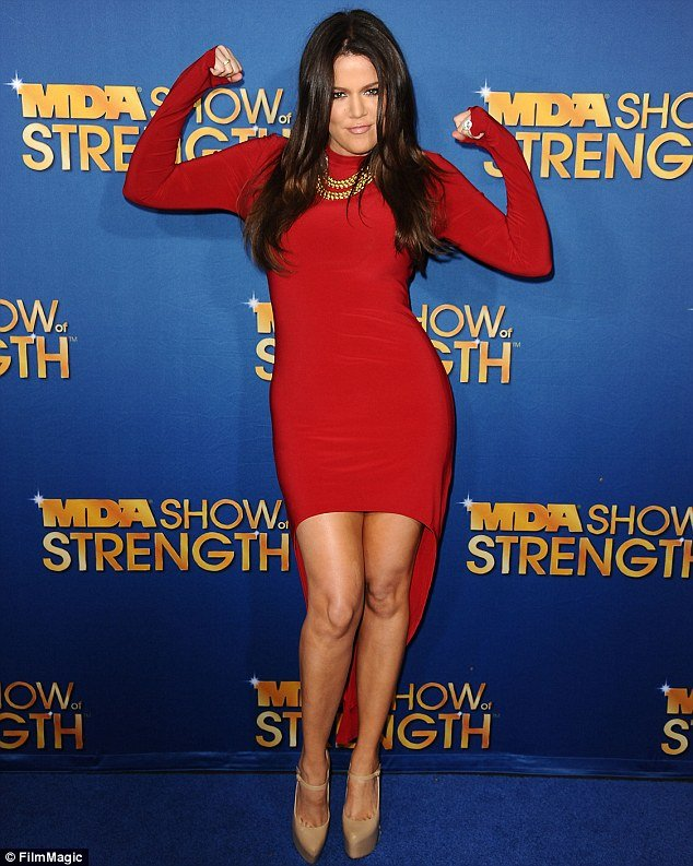 "Khloe Kardashian looked sizzling in a red ""mullet"" dress as she arrived at the MDA Labor Day Telethon in Los Angeles last night"