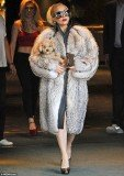 Lady Gaga stepped out in Bulgaria wearing what appeared to be a real fur coat as she left her hotel carrying a puppy