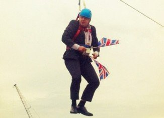 London's Mayor Boris Johnson was left dangling on a zip wire for several minutes when it stopped working at an Olympic live screen event