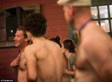 Mark Zuckerberg caressing his hairy chest while obviously having a very good time cavorting with the other topless men