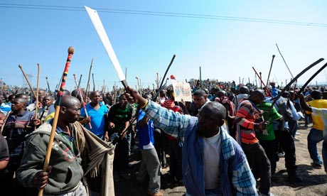 Miners arrested at Lonmin Marikana mine in South Africa will be charged later with the murder of 34 colleagues shot by police