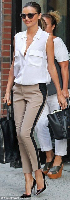 Miranda Kerr has been spotted creating the illusion of a skinnier size thanks to a dark panel down the side of the trousers