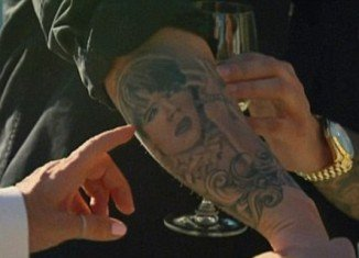 Rob Kardashian has his mother's face permanently tattooed on his body, covering his right forearm