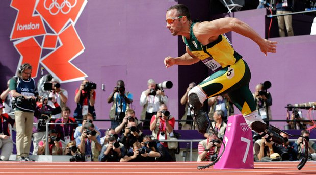 South African athlete Oscar Pistorius made history at London Games 2012 by becoming the first amputee sprinter to compete at the Olympics photo