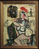 "The Evansville Museum says Picasso glass artwork titled ""Seated Woman with Red Hat"" was donated to the museum in 1963"