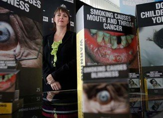 The highest court of Australia has upheld a new government law on mandatory packaging for cigarettes that removes brand colors and logos from packaging
