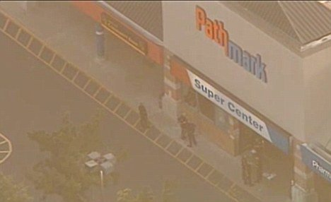 Three people have been shot dead after a gunman walked into a New Jersey Pathmark store and killed two staff members including an 18-year-old girl