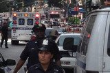 Two people have been killed, including a gunman, and ten others are wounded in a shootout near New York's Empire State Building