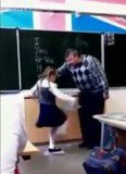 A Russian little girl cracks after receiving a lengthy telling-off by her bullying teacher and gives him a powerful kick in the groin