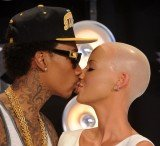Amber Rose and her rapper fiancé Wiz Khalifa did not plan the alleged pregnancy
