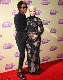 Amber Rose put a tender hand on her growing stomach as she joined fiancé, rapper Wiz Khalifa, on the red carpet at 2012 MTV VMAs