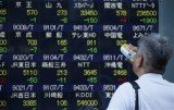 Asian markets have risen, following gains on Wall Street, after the US Federal Reserve unveiled its latest stimulus plan