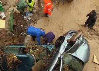 At least seven people have died after heavy rains triggered flash floods in southern Spain