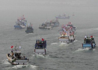 Dozens of Taiwanese boats sailed to disputed East China Sea islands in a brief protest