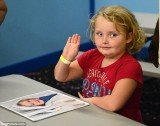 Honey Boo Boo signs autographs at the amusement arcade in Milledgeville