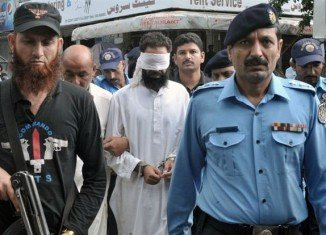 Imam Khalid Chishti has been remanded in custody, accused of planting pages of the Koran among burnt pages in the bag of a Christian girl held for blasphemy