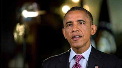 In his weekly radio and Internet address, President Barack Obama is asking people to remember the 9-11 victims and their families