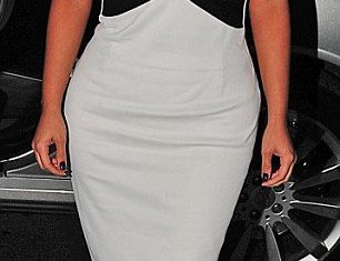 Kim Kardashian donned a daring, and rather revealing, monochrome dress to attend a magazine launch party in New York