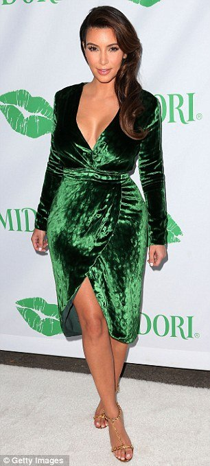 Kim Kardashian looked fantastic in her green velvet wrap dress from the front