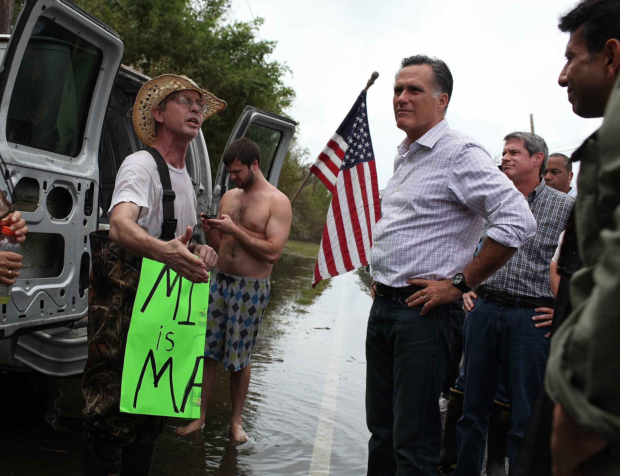 Mitt Romney has visited an emergency centre in hurricane-damaged Louisiana