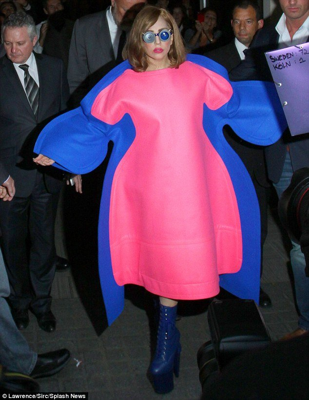 Only Lady Gaga would consider walking through the streets of Paris in what can only be described as a pink and blue blancmange-style dress