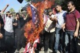 Palestinians burn a US flag during a protest against the movie, Innocence of Muslims, near the UN office in Gaza City