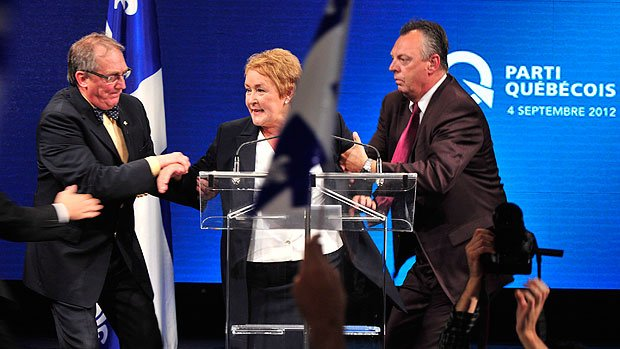 Parti Quebecois leader Pauline Marois was giving a victory speech in Montreal when shots were heard at the back of the hall photo